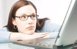 Woman watching laptop screen